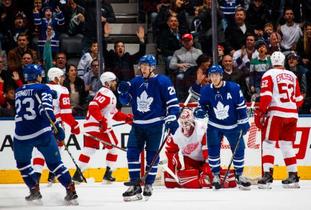 Connor Brown (centre) ties the game after deflecting Travis Dermott's (left, #23) shot past Jimmy Howard. Photo: Mark Blinch/NHLI via Getty Images