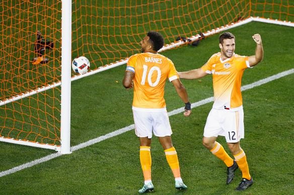 Giles Barnes (left) and Will Bruin (right) of the Houston Dynamo celebrate a first-half own goal against FC Dallas during their game at BBVA Compass Stadium on March 12, 2016 in Houston, Texas / Scott Halleran - Getty Images