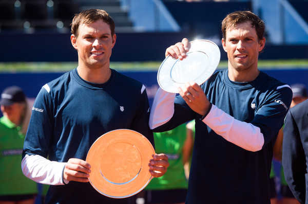 Bob (left) and Mike Bryan hold their trophies after winning Barcelona in April. Photo: Alex Caparros/Getty Images