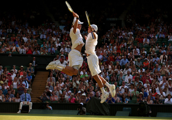 The Bryans do their famous chest bump after winning their third Wimbledon title in 2013. Photo: Julian Finney/Getty Images