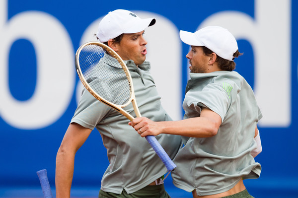 Bob (left) and Mike Bryan do their famous chest bump during a match in Barcelona. Photo: Alex Caparros/Getty Images