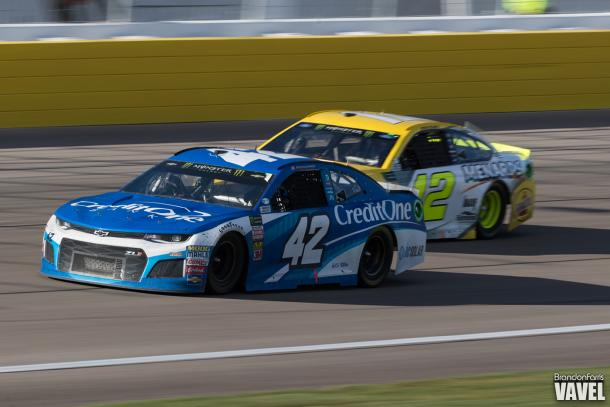 Kyle Larson passes Ryan Blaney late in the race.