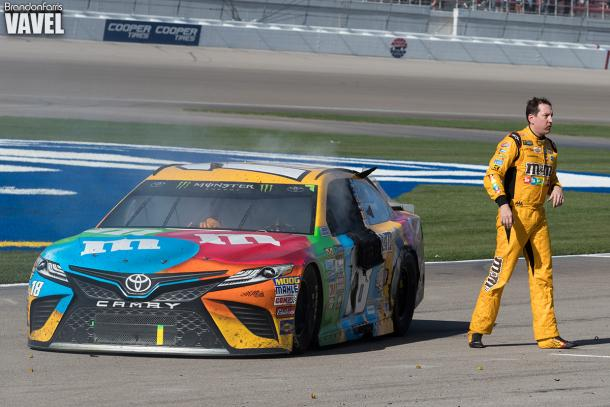 Kyle Busch walks away from his car.