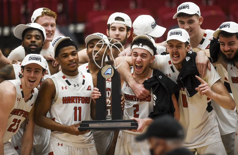 Hartford players pose with the trophy after defeating UMass-Lowell to win the America East title/Photo: Kassi Jackson/Hartford Courant