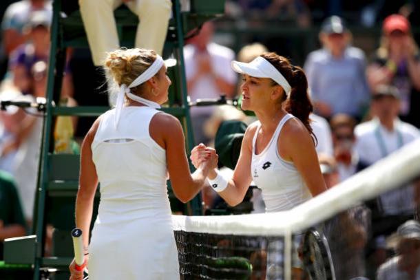 Timea Bacsinszky and Agnieszka Radwanska meet at the net following their third round encounter (Getty/Clive Brunskill)