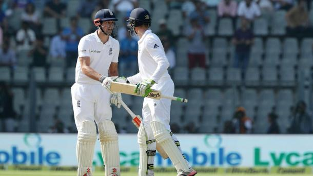 Jennings shakes hands with Cook after going past his half-century | Photo: ECB