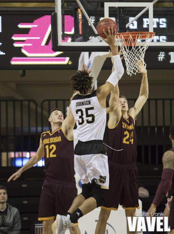 Brandon Johnson (35) gets up above both Central Michigan's Josh Kozinski (12) and Luke Meyer (24). Photo: Walter Cronk