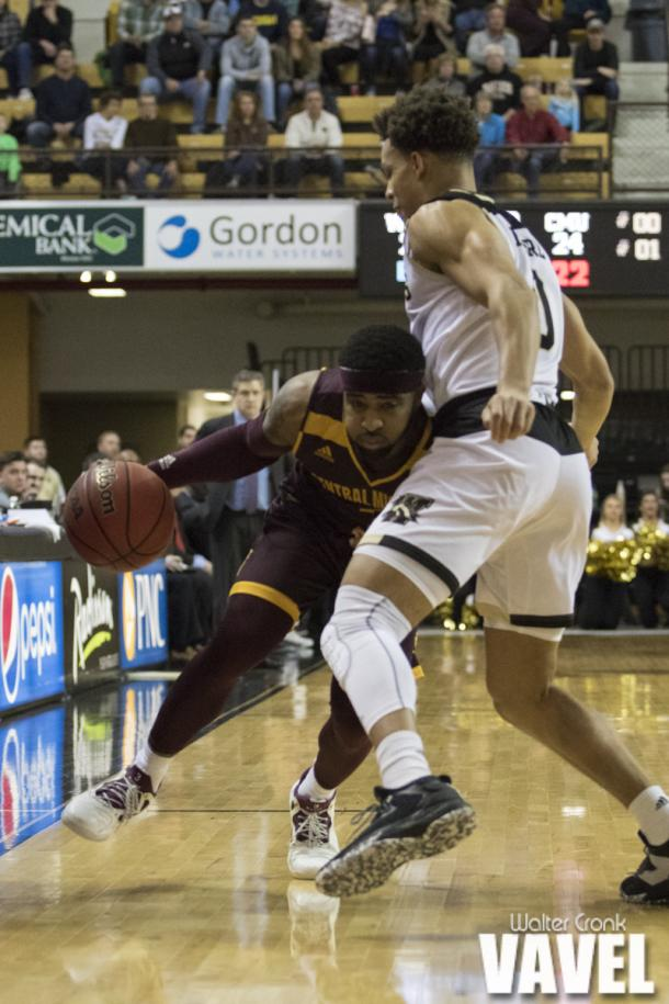 Marcus Keene (3) of Central Michigan tries to drive past Bryce Moore (0) of Western Michigan. Photo: Walter Cronk