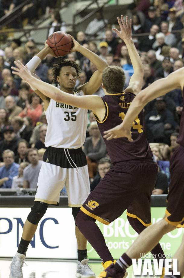 Late in the game, Brandon Johnson (35) looks for the open man to put the game out of reach for Central Michigan. Photo: Walter Cronk