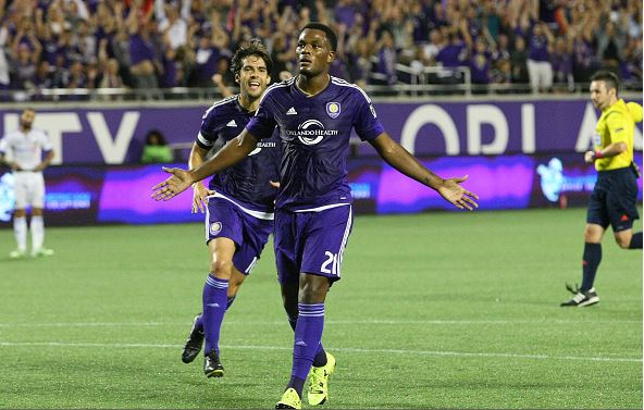 Cyle Larin #21 of Orlando City SC celebrates his first half goal during an MLS soccer match between the Montreal Impact and the Orlando City SC at the Orlando Citrus Bowl on October 3, 2015 in Orlando, Florida. (Photo by Alex Menendez/Getty Images
