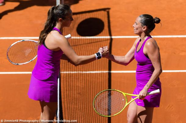 Daria Kasatkina and Roberta Vinci meet at the net after their meeting in Madrid earlier this year, in which Vinci triumphed in three sets | Photo: Jimmie48 Tennis Photography