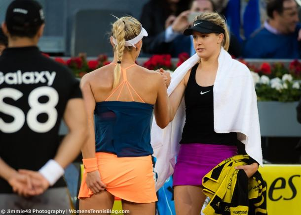 Eugenie Bouchard (R) shakes hands with Angelique Kerber (L) after the German retired from the match. (Photo: Jimmie48 Photography)
