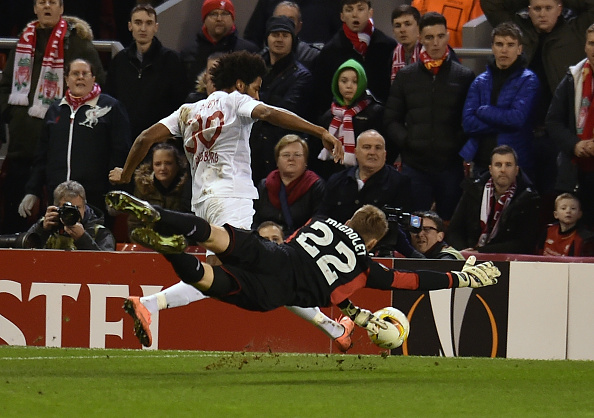 Caiuby fires for goal after rounding Simon Mignolet. (Getty)
