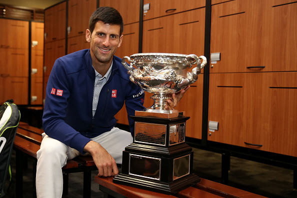 Novak Djokovic with the title last year (Getty/Cameron Spencer)