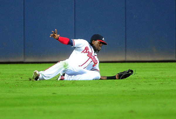 Cameron Maybin #22 of the Atlanta Braves makes a sixth inning sliding catch against the St. Louis Cardinals at Turner Field on October 2, 2015 in Atlanta, Georgia. (Oct. 1, 2015 - Source: Scott Cunningham/Getty Images North America)