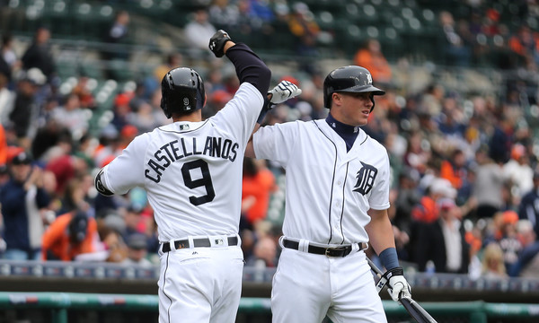 Nick Castellanos #9 of the Detroit Tigers celebrates with teammate James McCann #34 after hitting a solo home run during the second inning of the game against the Pittsburgh Pirates on April 11, 2016 at Comerica Park, Detroit, Michigan. (April 10, 2016 - Source: Leon Halip/Getty Images North America)