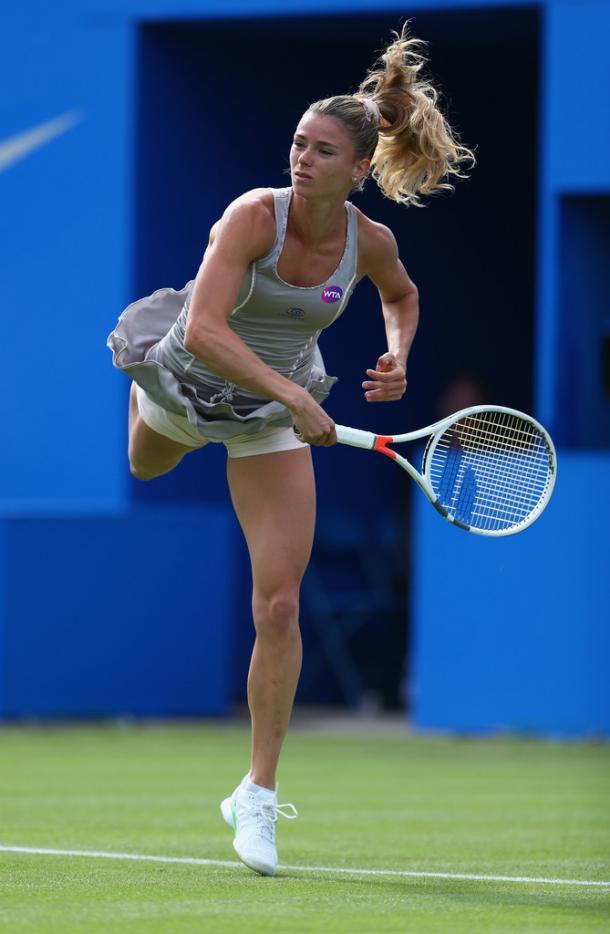 Camila Giorgi hitting a serve. | Photo: Getty Images