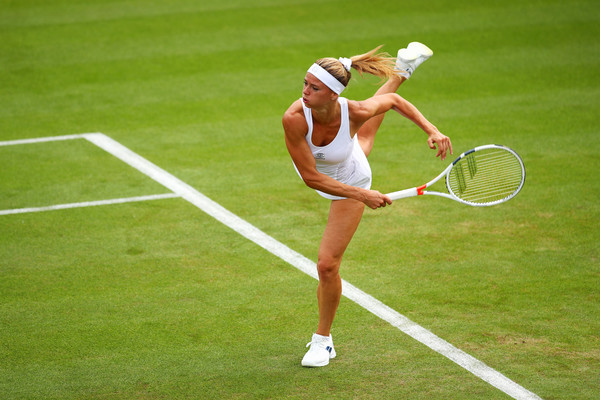 Camila Giorgi puts in a strong serve during today's match | Photo: Clive Brunskill/Getty Images Europe
