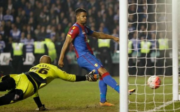 Campbell makes sure of the result with a simple tap in following good build-up play from Zaha and Adebayor | Photo: Getty images