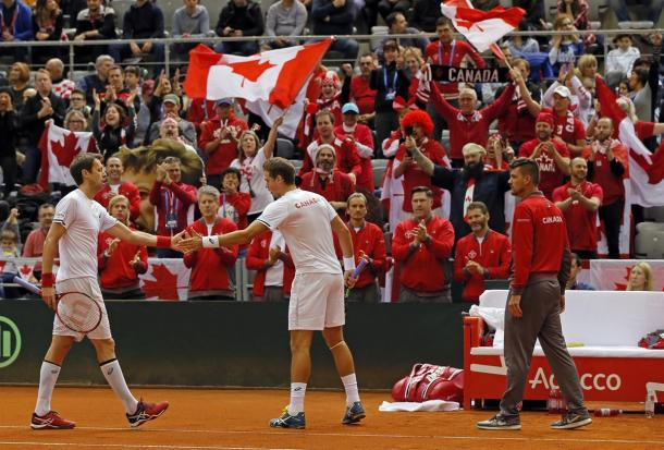 Nestor and Vasek Pospisil (right) celebrate in front of a surprisingly large Canadian contingent in Croatia. Photo: Predrag Milosavljevic/Davis Cup