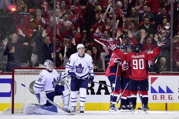 The Capitals celebrate Williams' game-tying goal. Photo: Patrick McDermott/Getty Images