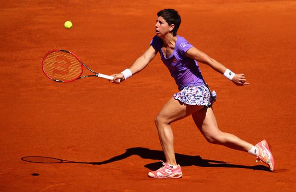 Carla Suarez Navarro in Mutua Madrid Open action. Photo: Clive Brunskill/Getty Images