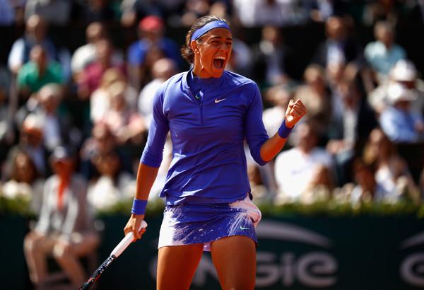 Caroline Garcia celebrates winning a point | Photo: Adam Pretty/Getty Images Europe