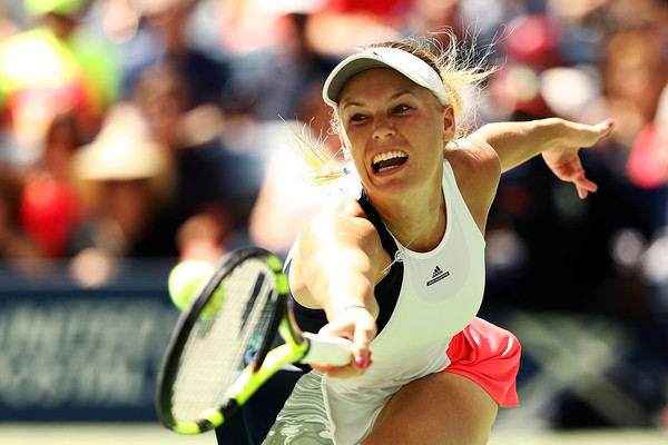 Caroline Wozniacki reaches for a backhand at the US Open in New York City/Getty Images