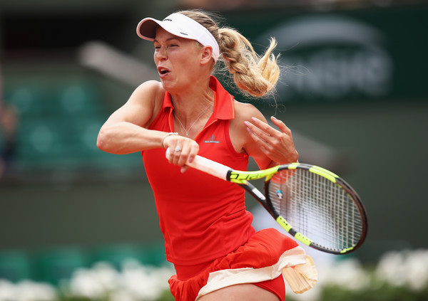 Caroline Wozniacki hits a forehand | Photo: Julian Finney/Getty Images Europe