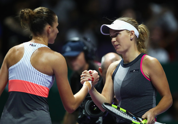 Respect: Pliskova congratulates Wozniacki at the net after her loss | Photo: Clive Brunskill/Getty Images AsiaPac