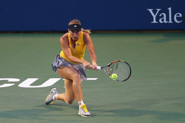 Wozniacki in tennis action in New Haven against Riske. Photo: Maddie Meyer/Getty Images