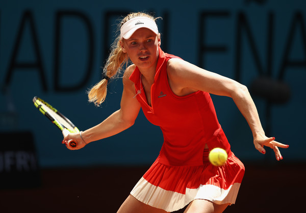 Ailing back forces No. 1 seed Caroline Wozniacki out at Strasbourg
