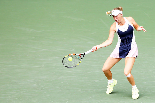 Caroline Wozniacki hits a forehand at the 2015 Toray Pan Pacific Open in Tokyo/Getty Images