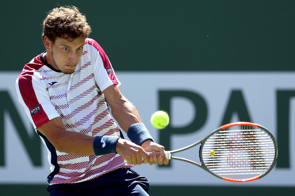 Pablo Carreno Busta hits a backhand during his semifinal loss. Photo: Matthew Stockman/Getty Images