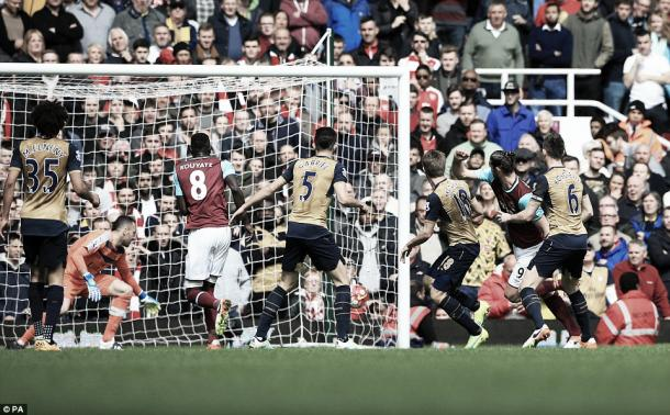 Above: Andy Carroll scoring his first of three goals in West Ham's 3-3 draw with Arsenal | PA