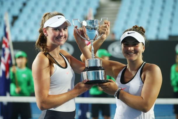 Bianca Vanessa Andreescu (right) and Carson Branstine pose with the Girls' Doubles winners' trophy after winning the 2017 Australian Open Junior Championships. | Photo: Pat Scala/Getty Images