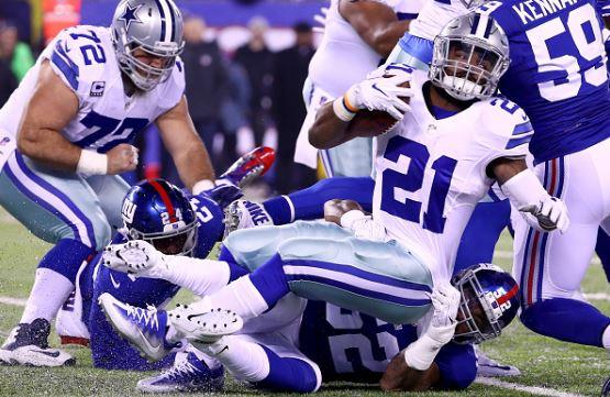Dallas Cowboys running back Ezekiel Elliott tackled by New York Giants linebacker Jonathan Casillas | Source:  Al Bello - Getty Images