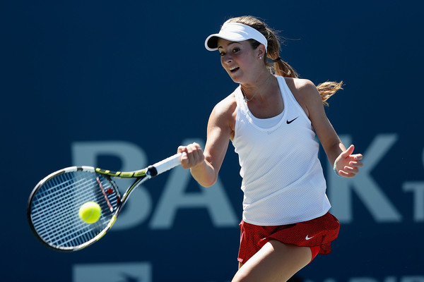 Catherine Bellis hitting a forehand | Photo: Lachlan Cunningham/Getty Images North America