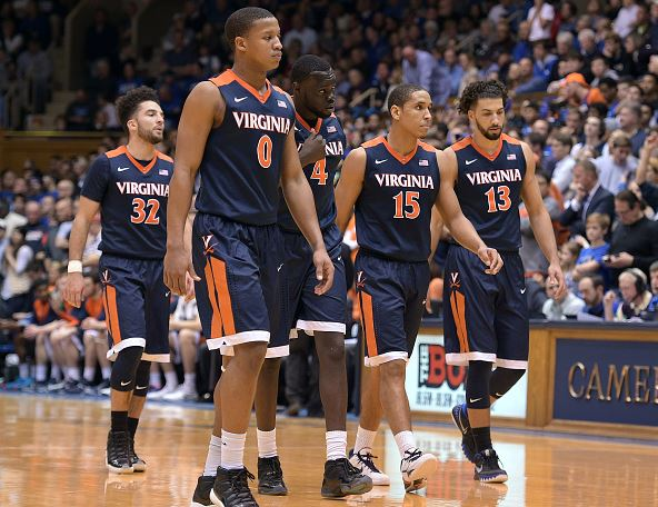 London Perrantes #32, Devon Hall #0, Marial Shayok #4, Malcolm Brogdon #15 and Anthony Gill #13 of the Virginia Cavaliers return to the court during their game against the Duke Blue Devils at Cameron Indoor Stadium on February 13, 2016 in Durham, North Carolina. Duke defeated Virginia 63-62. (Photo by Lance King/Getty Images