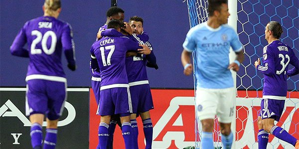 Hugs all around as Cyle Larin scores in the 7th minute to lead Orlando City early on Friday night  Photo: Orlando City