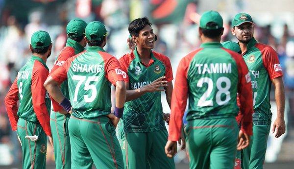 Mustafiqur celebrates with his teammates during his five wicket haul | Photo: icc.com