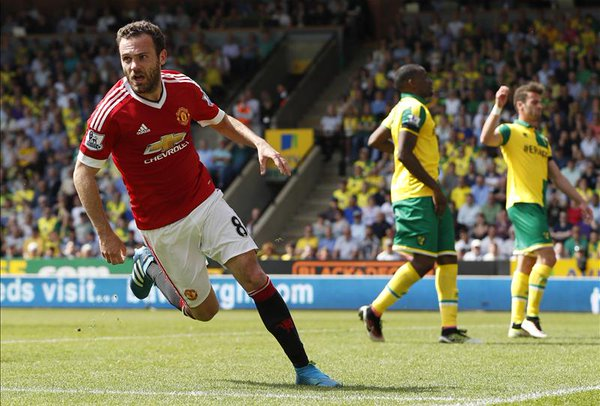 Mata wheels away in celebration after scoring the winner for the Reds