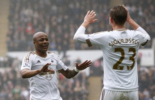 André Ayew celebrates with teammate Gylfi Sigurdsson after breaking the deadlock. (Photo: Swansea City AFC)