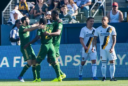 Diego Chara (center, green) celebrates after scoring the lone goal in the Timbers 1-0 victory over the Galaxy | Source: Shaun Clark - Getty Images