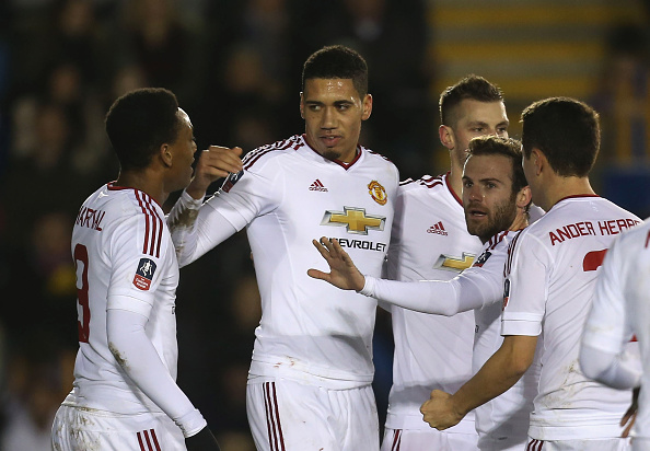 Chris Smalling celebrates a scruffy opener | Photo: John Peters/Manchester United