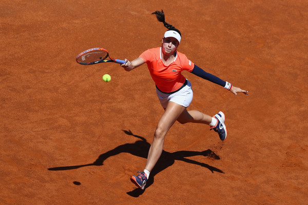 Christina McHale reaches out for a shot | Photo: Michael Steele/Getty Images Europe