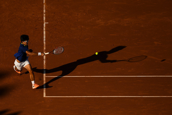 Hyeon Chung chases down a forehand during his loss in Barcelona. Photo: David Ramos/Getty Images