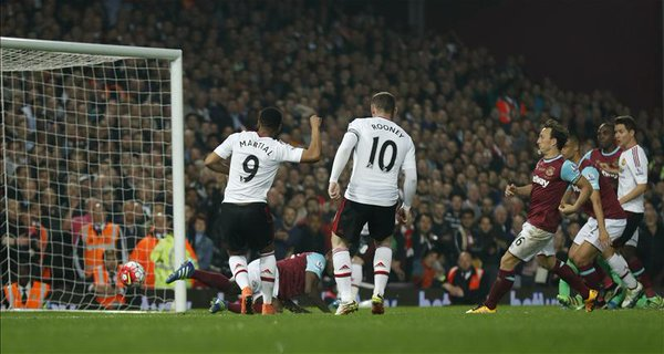 Martial tapping the ball into the net for his first goal of the night against West Ham | Photo: Getty Images