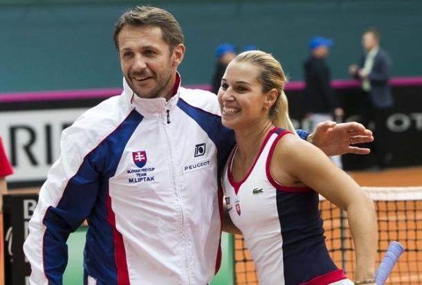 Slovakian captain Matej Liptak (left) and Cibulkova celebrate her victory. Photo: Roman Benicky/Fed Cup