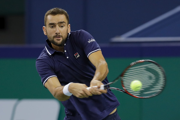 Marin Cilic crushes a backhand in Shanghai. Photo: Lintao Zhang/Getty Images